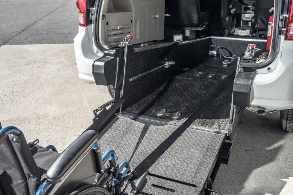 Rear entry wheelchair accessible conversion mini van ramp